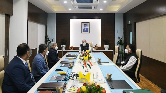 Prime Minister Narendra Modi talking to scientists and officials at Zydus Biotech on  the progress in the development of a COVID-19  vaccine, in Ahmedabad, on November 28, 2020.
