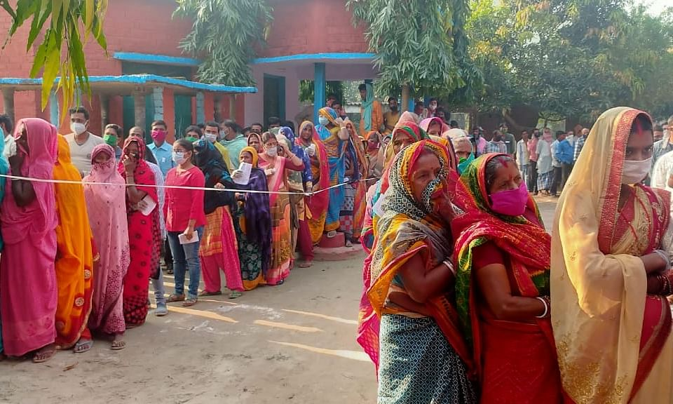 Women voters queueing up at a polling station to cast their votes in the third and last phase of the Bihar Assembly elections, in Saharsa on November 7, 2020.