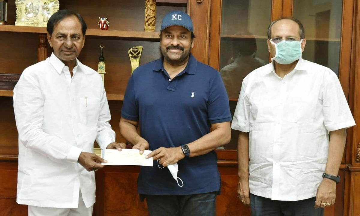 Telugu actor Chiranjeevi (centre) with Telangana Chief Minister (left) in Hyderabad on November 7, 2020.