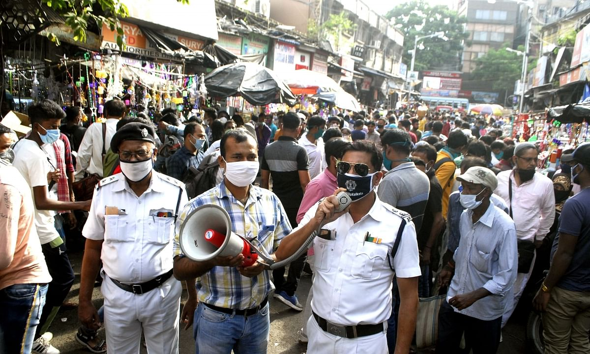 Police making announcements warning people against burning of firecrackers after the Calcutta High Court banned the use and sale of firecrackers during Kali Puja and Diwali, keeping in mind the Covid-19 pandemic situation in West Bengal, in Kolkata on November 12, 2020.