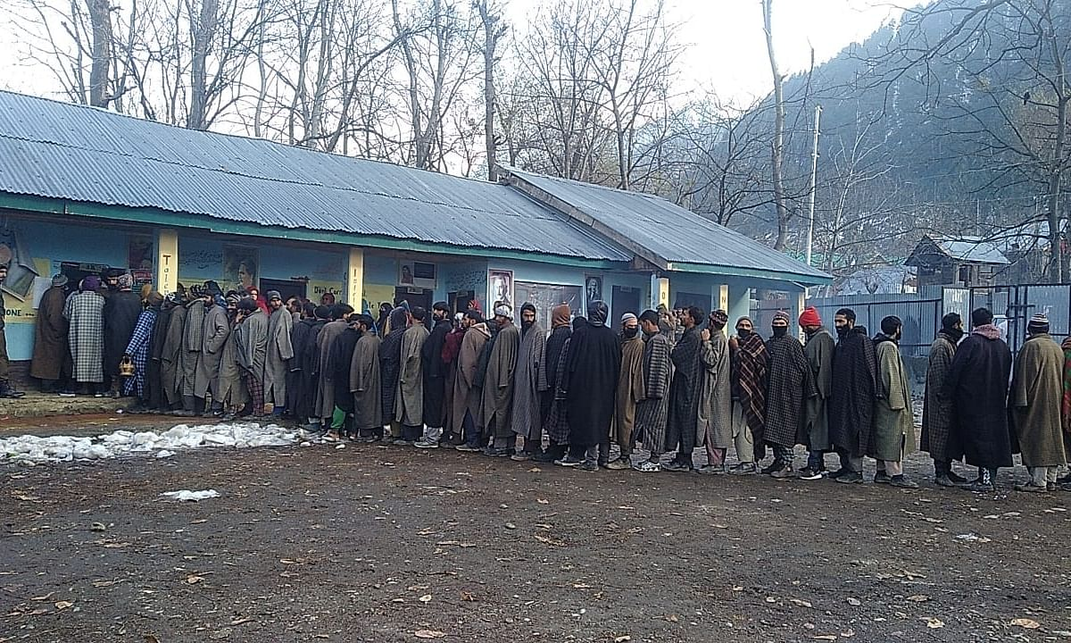 People queueing up outside a polling station to cast their votes in the first phase of the District Development Council (DDC) elections, at Pahalgam in Jammu and Kashmir's Anantnag district on November 28, 2020.