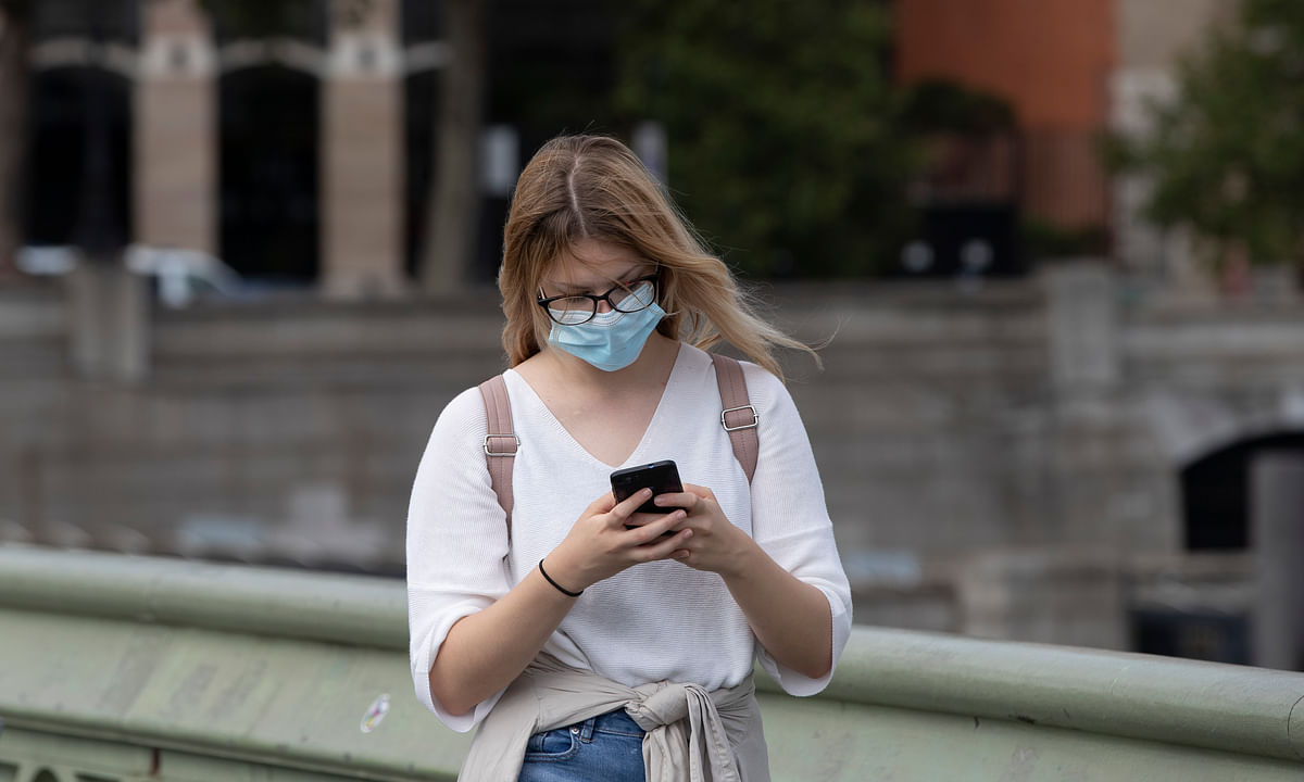 A woman wearing a face mask walks on Westminster Bridge in London, Britain, on September 8, 2020.