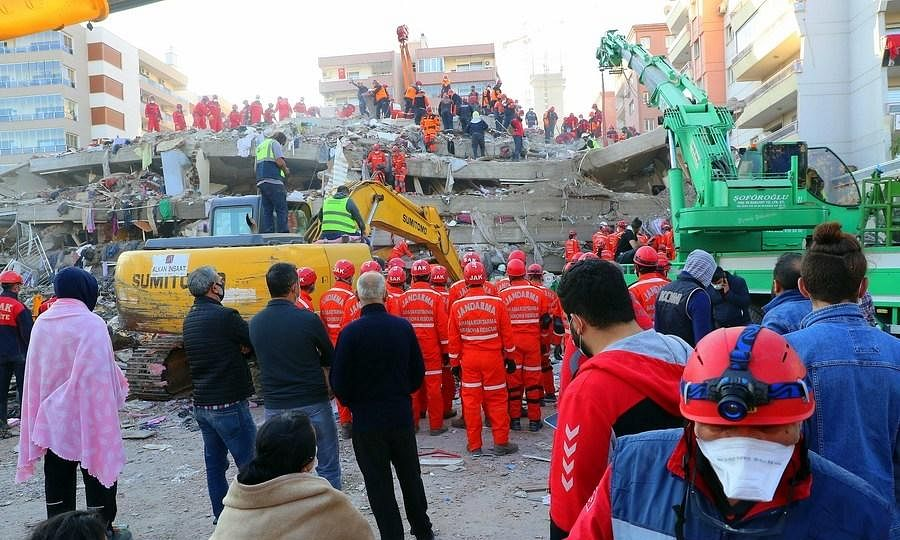 Rescuers working at the site of a collapsed building on October 31, 2020, after a strong earthquake that hit Turkey's western province of Izmir a day earlier.