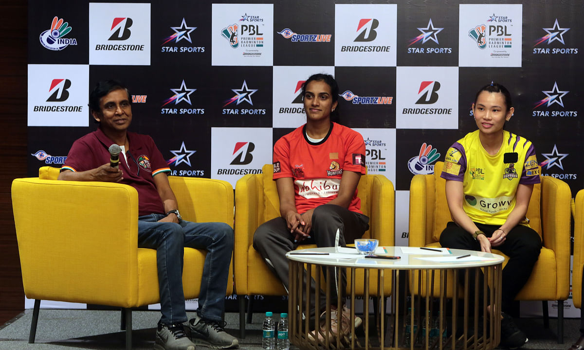 File photo of Prasad Mangipudi, MD, SportzLive with badminton stars P V Sindhu and Tai Tzu during an event on the sidelines of Season 5 of the Premier Badminton League.