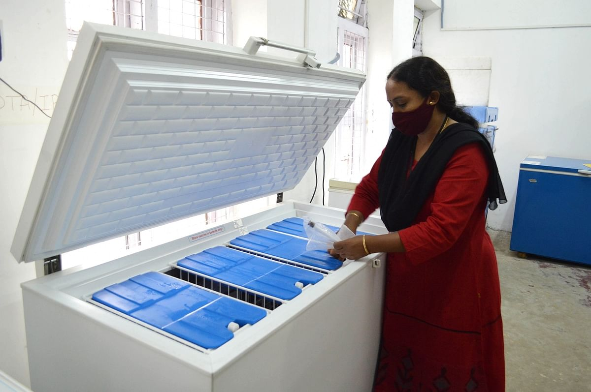 A pharmacy officer conducting checks at the Electronic Vaccine Intelligence Network (EVIN) cold storage equipment at N Dasappa Thirumalamma Maternity Hospital, proposed by the Bangalore Municipal Corporation for the storage and despatch of Covid-19 vaccines when available, in Bengaluru on November 26, 2020.