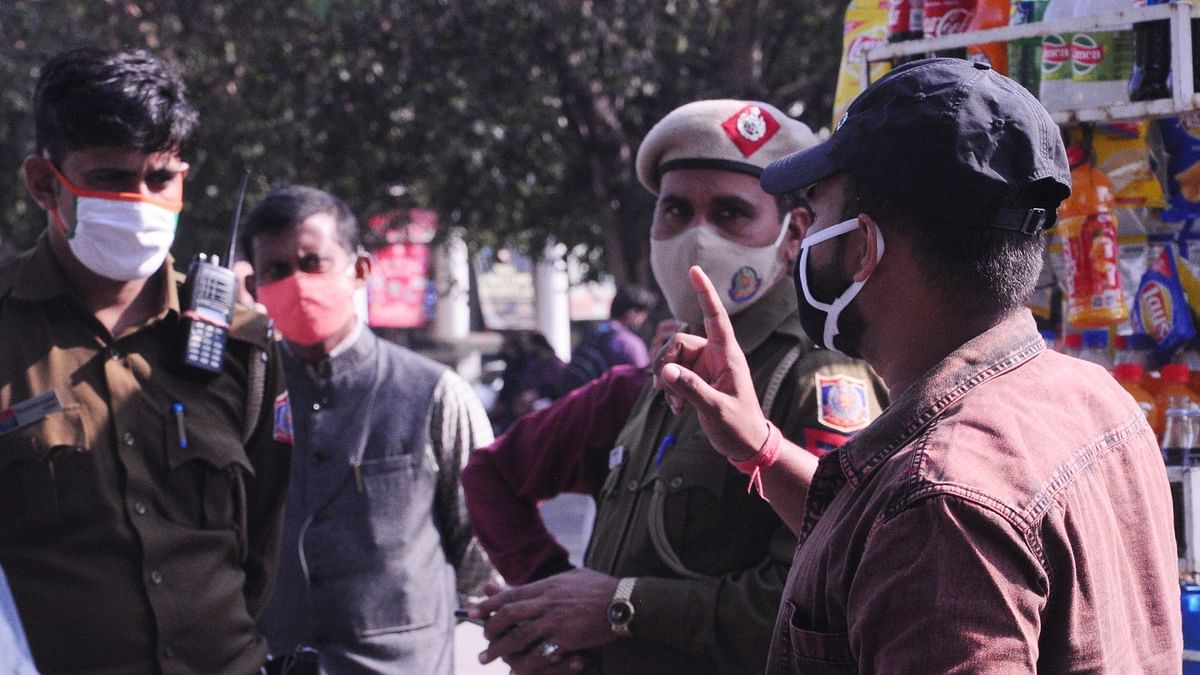 A young man being fined Rs 2000 by the Delhi Police for violating COVID-19 guidelines after he was found clicking selfies in a public place while wearing his mask incorrectly under his nose, in New Delhi on November 21, 2020.