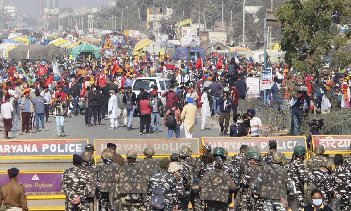Farmers from Punjab and Haryana march to Delhi during their protest against the Central Farm Laws amid high security, at Sindu Border in New Delhi on November 27, 2020.