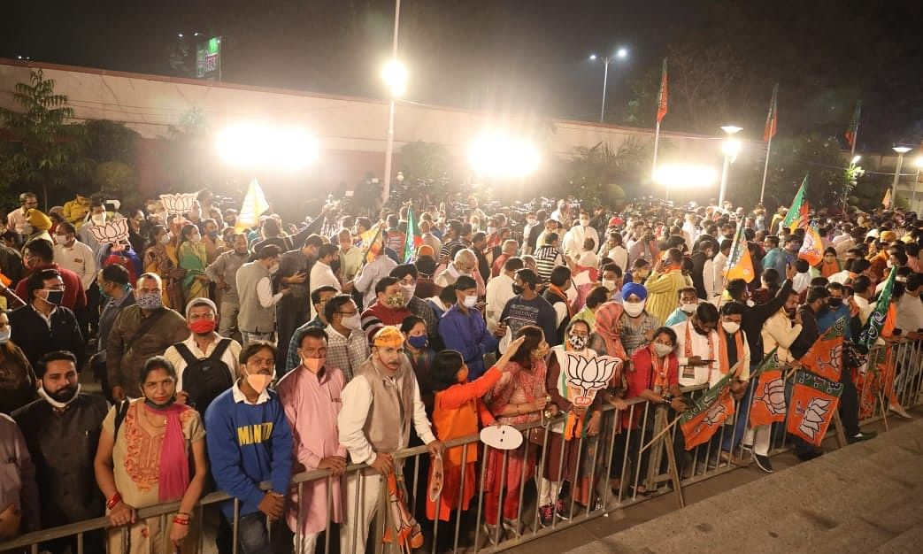 BJP supporters gathered outside the party's headquarters in Delhi after its victory in  the elections in Bihar and bye-elections in various  states, on November 10, 2020.