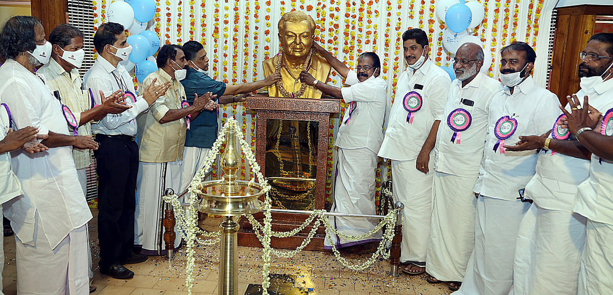 Milma Chairman P A Balan Master and MRCMPU Chairman K S Mani garland the bust of India's Milkman Dr Verghese Kurien at Milma's Malabar Regional Co-operative Milk Producers Union headquarters in Kozhikode on November 26, 2020.