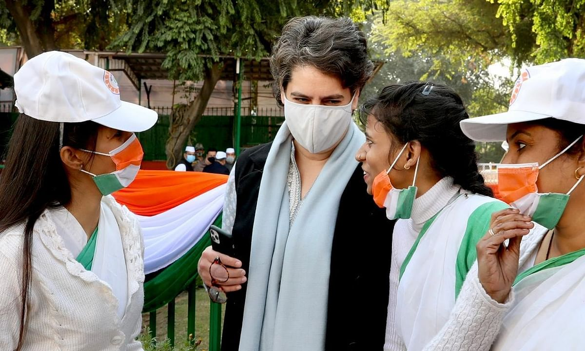 Congress General Secretary Priyanka Gandhi Vadra with party workers during its 135th Foundation Day  celebrations at its headquarters in New Delhi, on December 28, 2020.