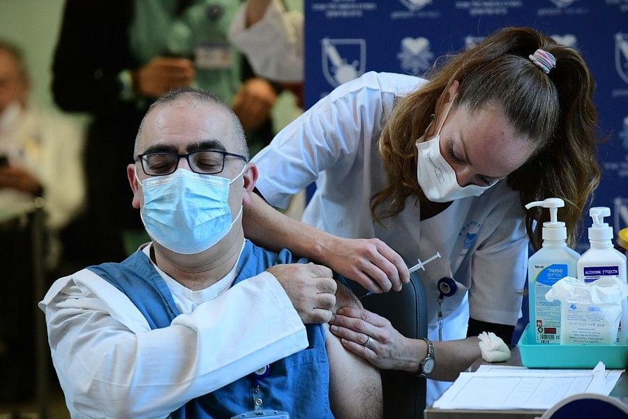 An Israeli medical worker receives a COVID-19 vaccine at the Sourasky Medical Center in Tel Aviv, Israel, on December 20, 2020.