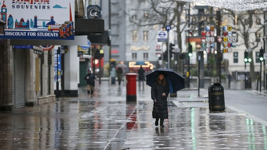 A woman walking on a near-empty street near Leicester Square in London, Britain, on December 21, 2020.