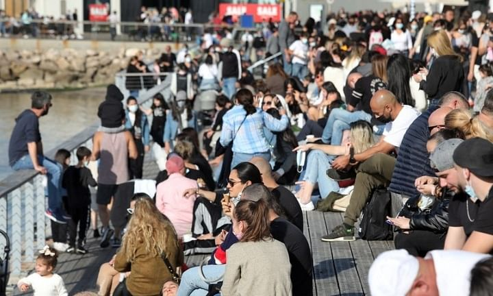 Israelis enjoying a sunny day in the center of Tel Aviv amid the COVID-19 pandemic on December 26, 2020, one day before the start of a third national lockdown.