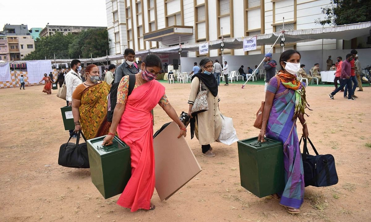 Polling officials collecting election material on the eve of the Greater Hyderabad Municipal Corporation (GHMC) elections, in Hyderabad on November 30, 2020.