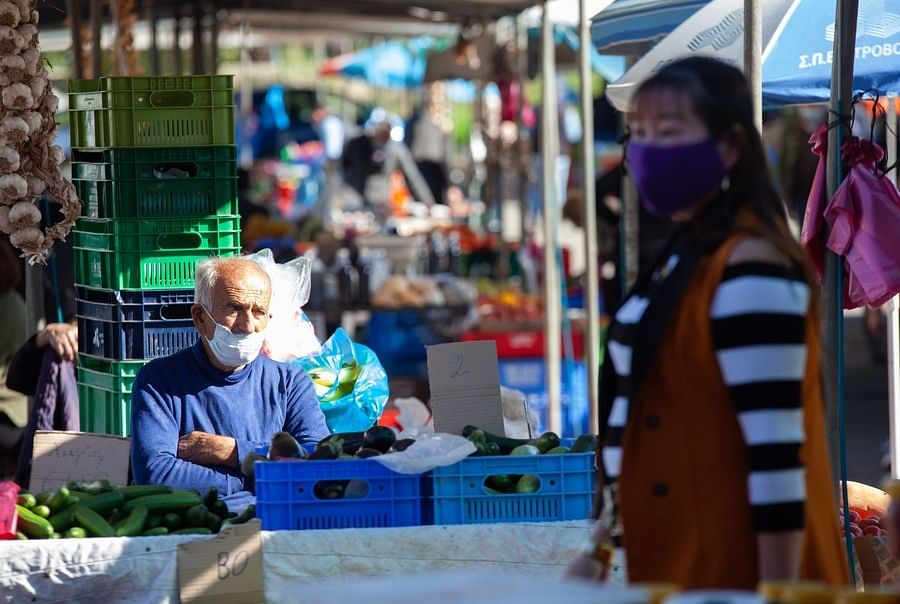 People wearing masks seen at a food market in Nicosia, Cyprus, on December 9, 2020.