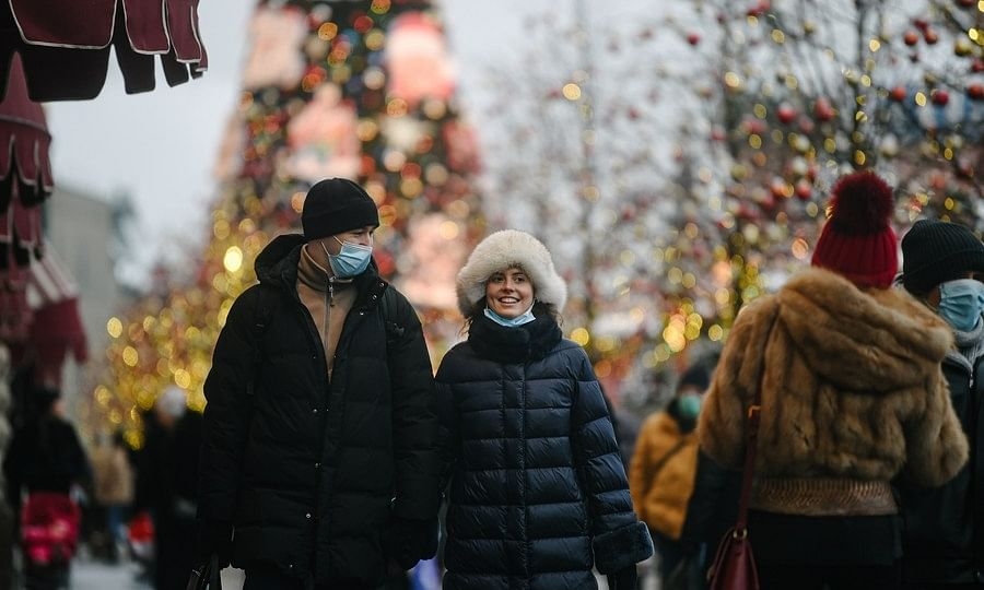 Pedestrians walking on a street in Moscow, Russia, on December 16, 2020.