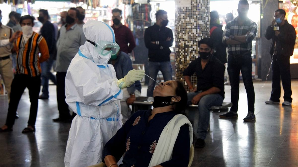 India registers 391 more COVID-19 deaths, 30,254 new cases of infection