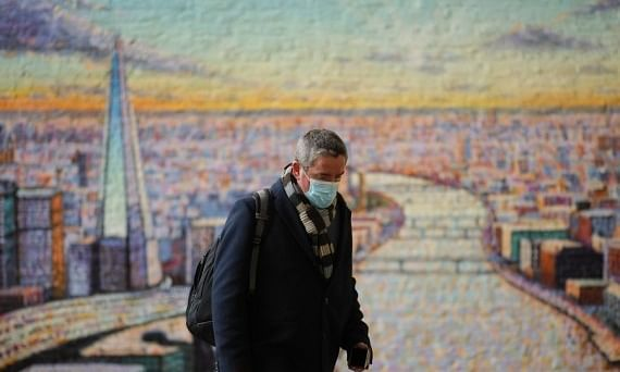 A person walking past a mural painting of London, in London, Britain, on December 16, 2020.