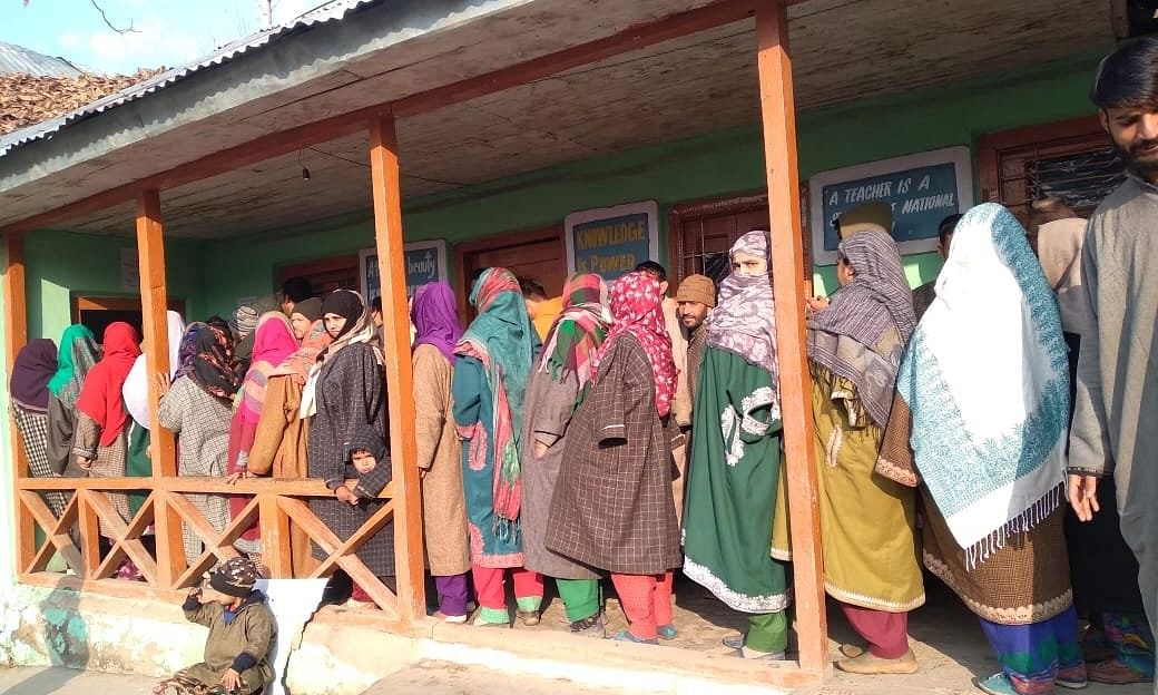 File photo of voters queueing up to vote in an earlier phase of elections to District Development Councils in Jammu & Kashmir.