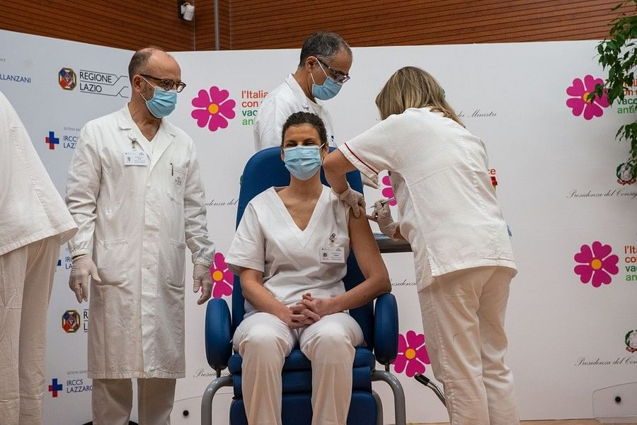 A medical worker being vaccinated against COVID-19 at the Spallanzani Hospital in Rome, Italy, on December 27, 2020.