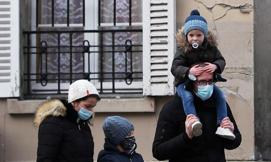 People wearing masks visiting the Montmartre to welcome the New Year in Paris, France, on January 1, 2021.