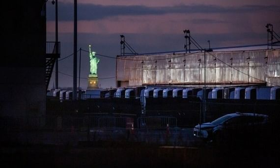 A COVID-19 disaster morgue made up of refrigerated trailers stands at the South Brooklyn Marine Terminal during the COVID-19 pandemic in the Brooklyn borough of New York, United States, on December 14, 2020.