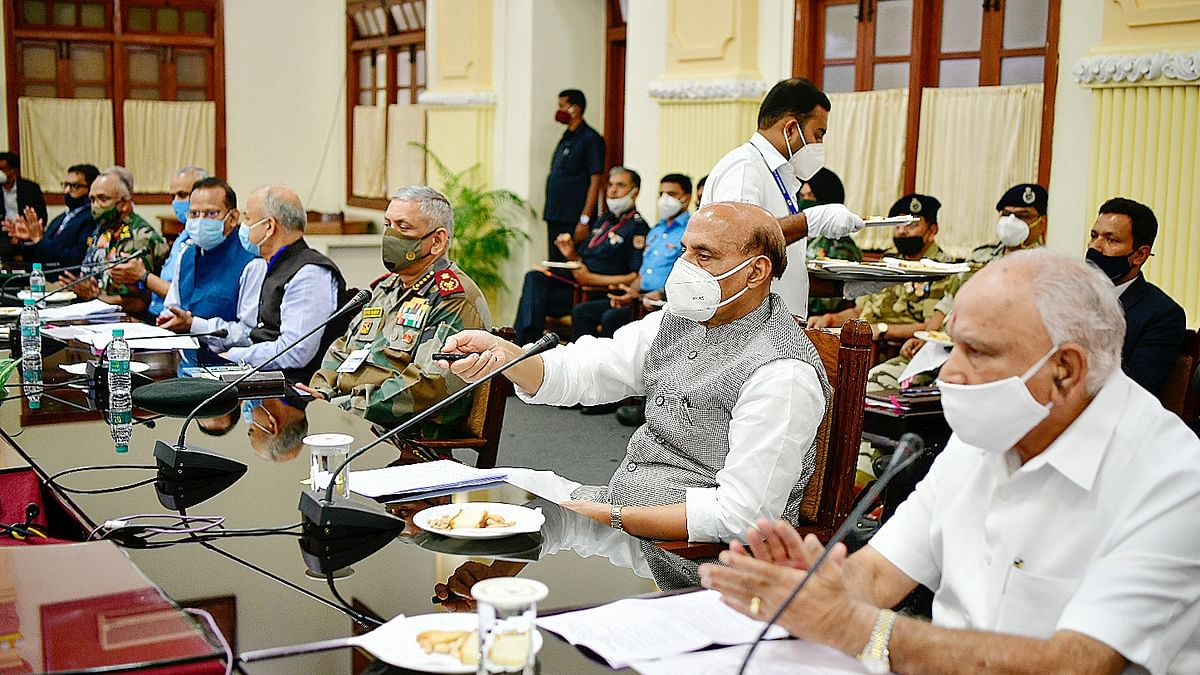 Defence Minister Rajnath Singh with Karnataka Chief Minister B. S.  Yediyurappa, Chief Defense Staff General Bipin Rawat and officials at a meeting on Aero India 2021 in Bengaluru on January 15, 2021.