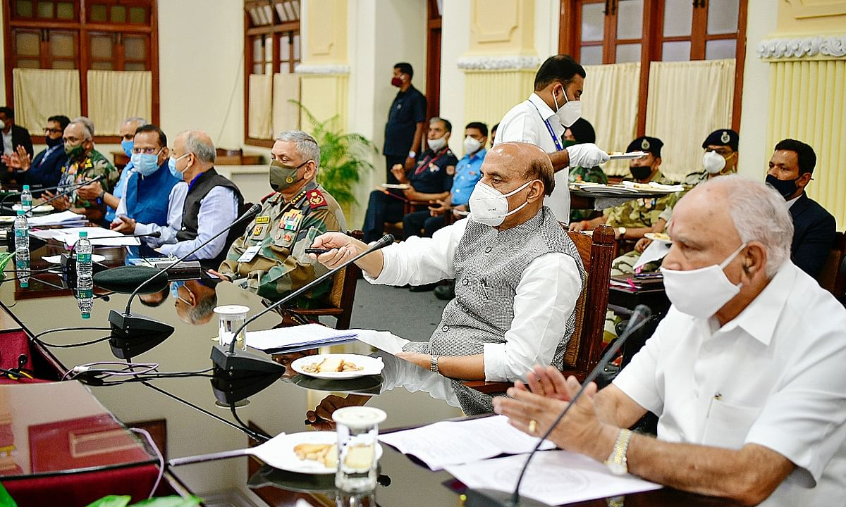 Defence Minister Rajnath Singh with Karnataka Chief Minister B. S.  Yediyurappa, Chief Defense Staff General Bipin Rawat and officials at a meeting on Aero India 2021 in Bengaluru on January 15, 2021.