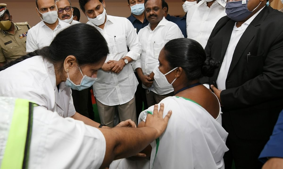 A health worker being vaccinated against COVID-19 at the start of the nationwide vaccination drive, in the presence of  Andhra Pradesh Chief Minister Y. S. Jagan Mohan Reddy, at the Government General Hospital in Vijayawada on January 16, 2021.