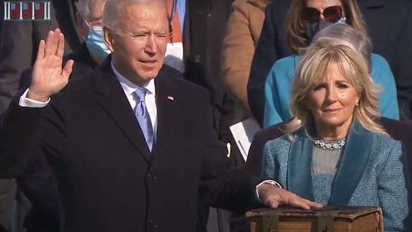 Harris, Biden take over leadership of fractured US with call for unity