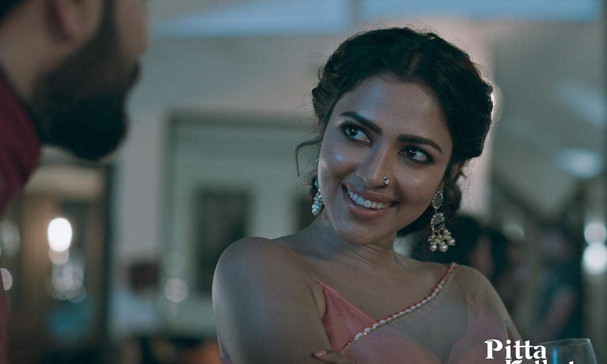 Amala Paul in a still from Telugu film Ptta Kathalu