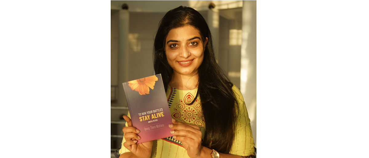 Anita Peter, with her book