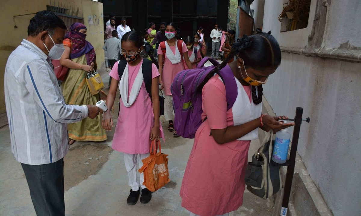 Students wearing masks and sanitizing their hands at a school in Hyderabad as schools and colleges reopened for physical classes in Telangana after remaining closed for nearly 11 months because of the COVID-19 pandemic, on February 1, 2021.
