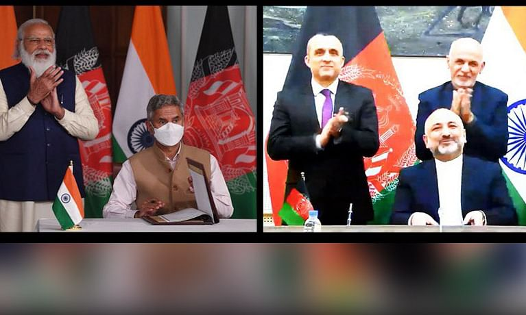 External Affairs Minister S Jaishankar and Afghan Foreign Minister Hanif Atmar signing a memorandum of understanding (MoU) for the construction of the Lalandar (Shatoot) Dam in Afghanistan through video conferencing, in the presence of Prime Minister Narendra Modi and Afghan President Mohammad Ashraf Ghani, on February 9, 2021.