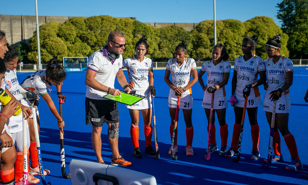 Chief Coach Sjoerd Marijne with members of the Indian women's hockey team.
