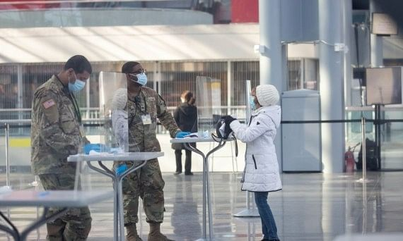 National Guard members assisting people at a COVID-19 vaccination centre at the Jacob K. Javits Convention Center in New York, the United States, on January 23, 2021.