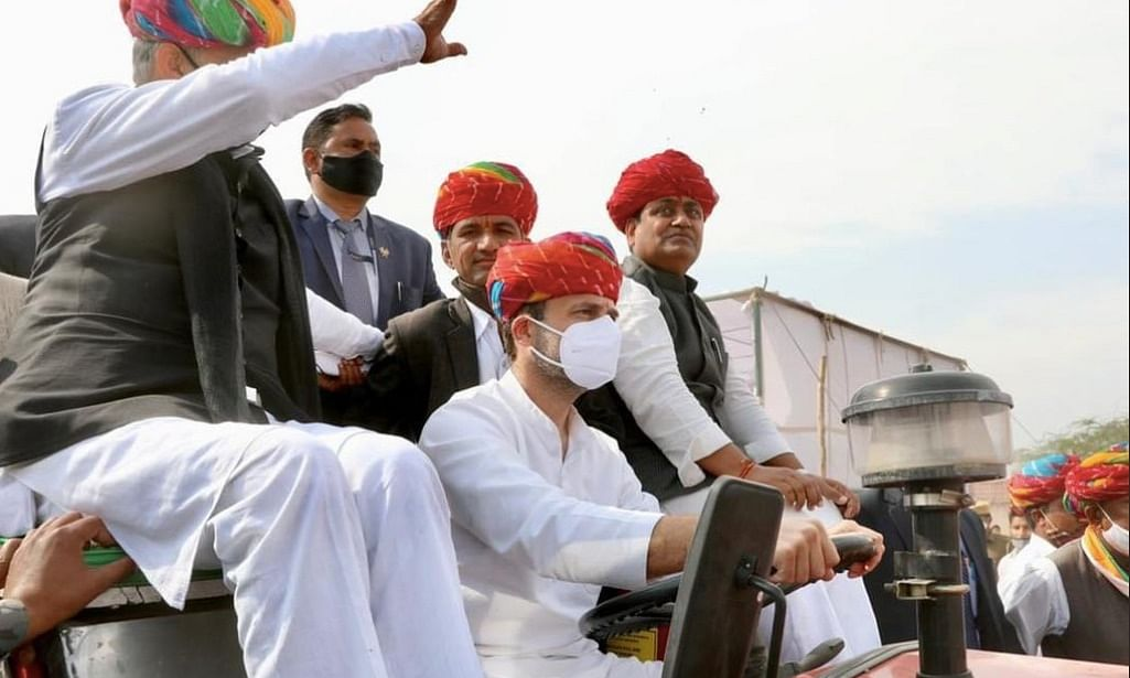 Congress leader Rahul Gandhi driving a tractor to be a part of a farmers' tractor rally at Rupangarh in Rajasthan on February 13, 2021.