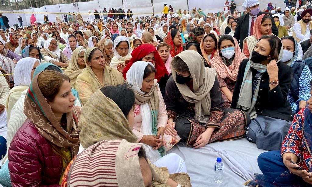 Congress General Secretary Priyanka Gandhi Vadra with  the family of farmer Navreet Singh, who had died during the Republic Day violence in Delhi when his tractor overturned at Dibdiba village of Rampur district in Uttar Pradesh, on February 4, 2021.