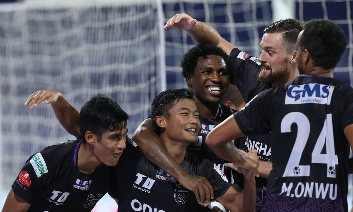 Odisha FC players congratulate Jerry Mawihmingthanga (second from left) after he bagged his second goal of the night in their match against East Bengal, in the Indian Super League, at Bambolim, Goa on February 27, 2021.