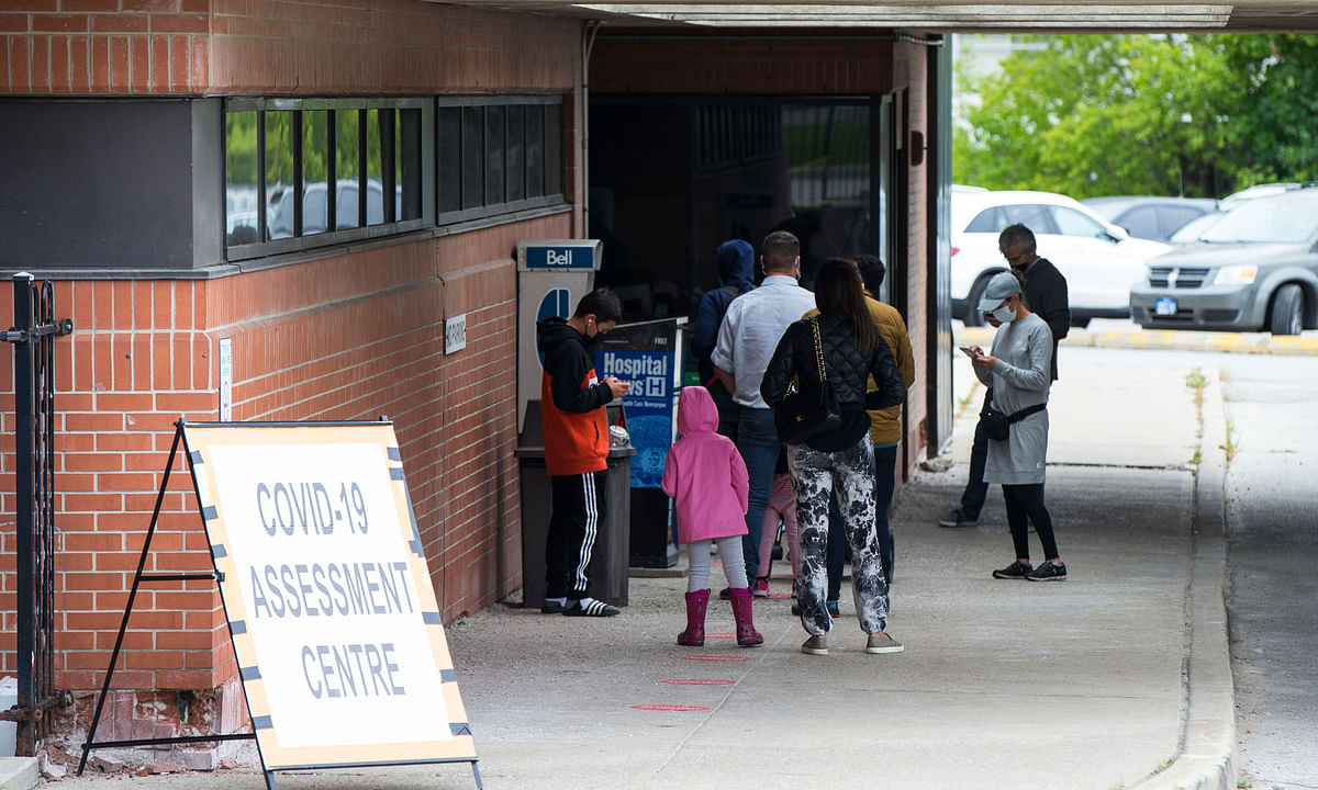 File photo of people line up to have COVID-19 tests outside a COVID-19 assessment centre in Toronto, Ontario, Canada, on September 8, 2020.