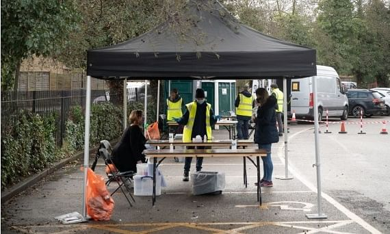 People taking coronavirus tests at a temporary COVID-19 testing facility set up in Ealing, a district in western London, Britain, on February 2, 2021.