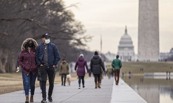 People wearing face masks visiting the Lincoln Memorial Reflecting Pool in Washington, D.C., the United States, on January 24, 2021.