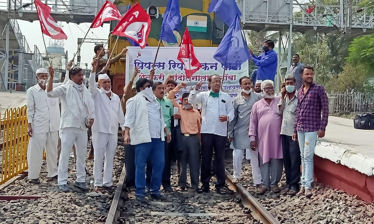 Farmers protesting on the rail tracks near Nashik in Maharashtra, as part of the nationwide Rail Roko agitation called by farmers' unions, on February 18, 2021.