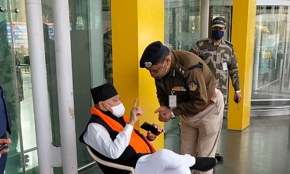Prime Minister Narendra Modi's brother Prahlad Modi staging a sit-in at Lucknow airport, on February 3, 2021.
