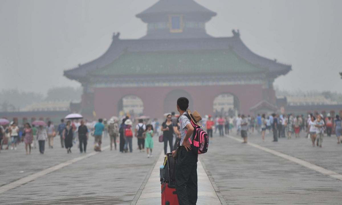File photo of fog shrouding the Temple of Heaven in Beijing, capital of China.