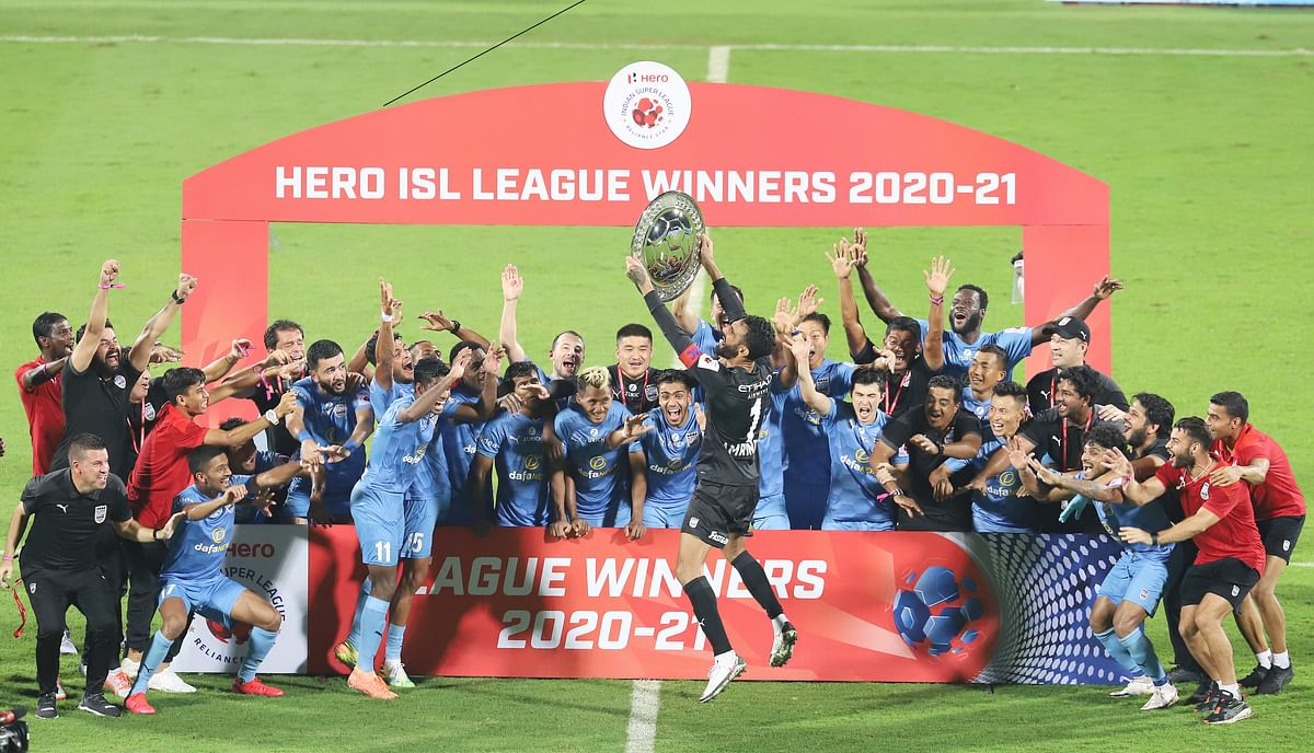 Mumbai City FC players celebrating with the League Winners Shield after winning 2-0 against ATK Mohun Bagan in the last league match of Indian Super League, at Bambolim on February 28, 2021.
