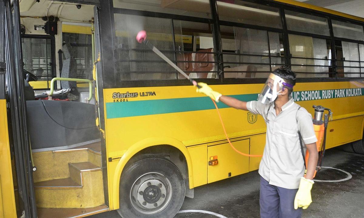 Health workers sanitizing a school bus, in Kolkata, on February 12, 2021.
