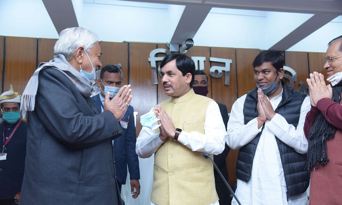 Bihar Chief Minister Nitish Kumar (left) with Shahnawaz Hussein (centre) and other newly-inducted Ministers, after the expansion of his Cabinet, in Patna on February 9, 2021.