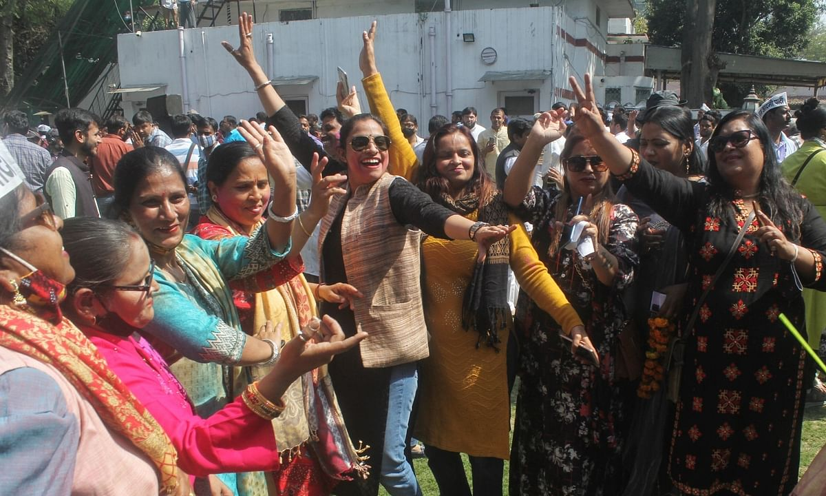 Aam Aadmi Party supporters celebrating after the party won of the five seats in the Municipal Corporation of Delhi bye-elections, in New Delhi, on March 3, 2021.