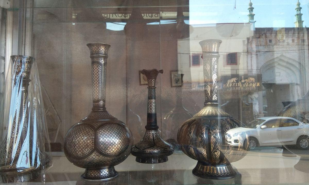 Bidra craft artefacts on display in a shop, overlooking the streets of Bidar.